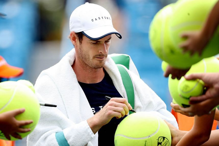 Murray signs autographs after a training session during the Western & Southern Open.