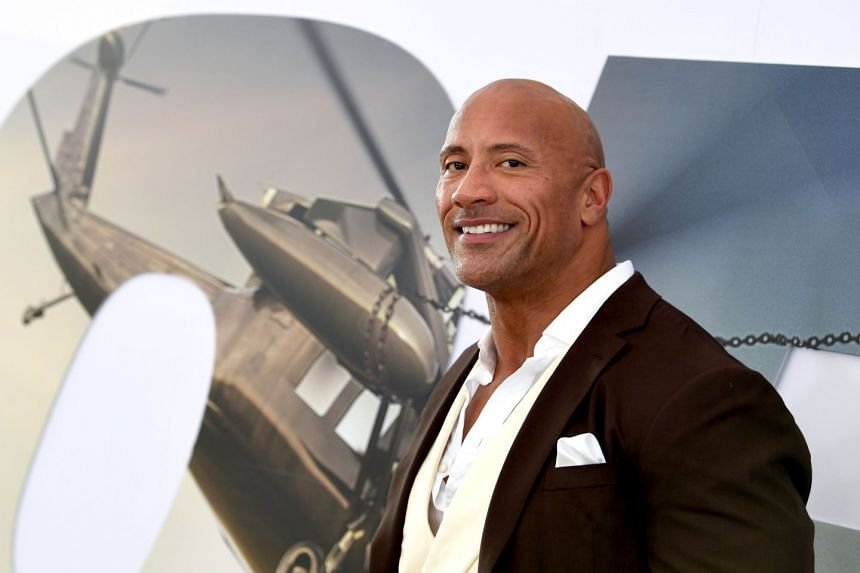 Dwayne Johnson arrives at the premiere of Universal Pictures' Fast & Furious Presents: Hobbs & Shaw.
