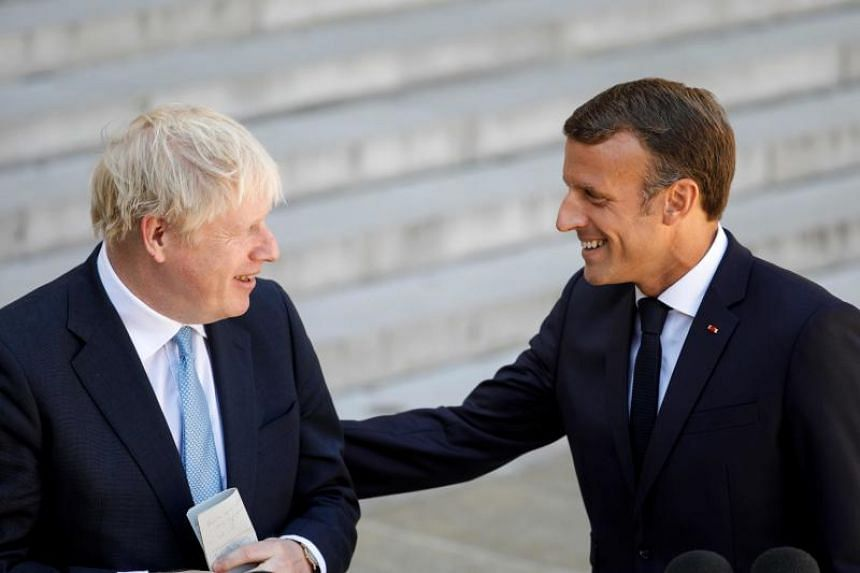 Britain's Prime Minister Boris Johnson (left) and French President Emmanuel Macron speak to the press ahead of a meeting at The Elysee Palace in Paris on Aug 22, 2019.