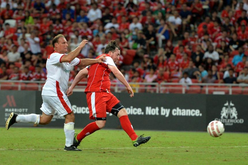 In a photo taken on Nov 14, 2015, Liverpool Masters' Robbie Fowler (in red) attempts a shot as Manchester United Masters' Clayton Blackmore tries to intervene during the last time both Masters sides faced each other at the National Stadium in Sin