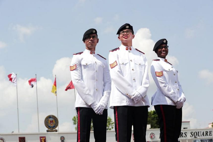 (From left) 3SG Saif Erfan Bin Mohamed, Armoured Infantry Specialist, 3SG Tan Jia Le, Cyber (Specialist), Golden Bayonet Recipient and 3SG Thaneswari D/O P Manoharan, Signals Specialist, at the 40th Specialist Cadet Graduation Parade on Aug 22, 2019.