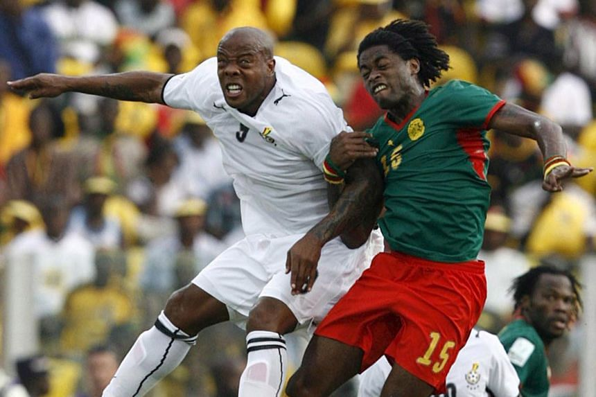 A 2008 photo shows Agogo (left) in actions against Cameroon's Alexander Song during the Africa Nations Cup.