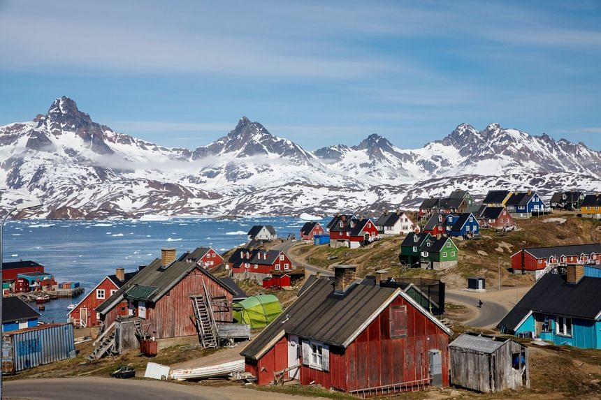 A 2018 photo shows snow-covered mountains rising above the harbour and town of Tasiilaq, Greenland.