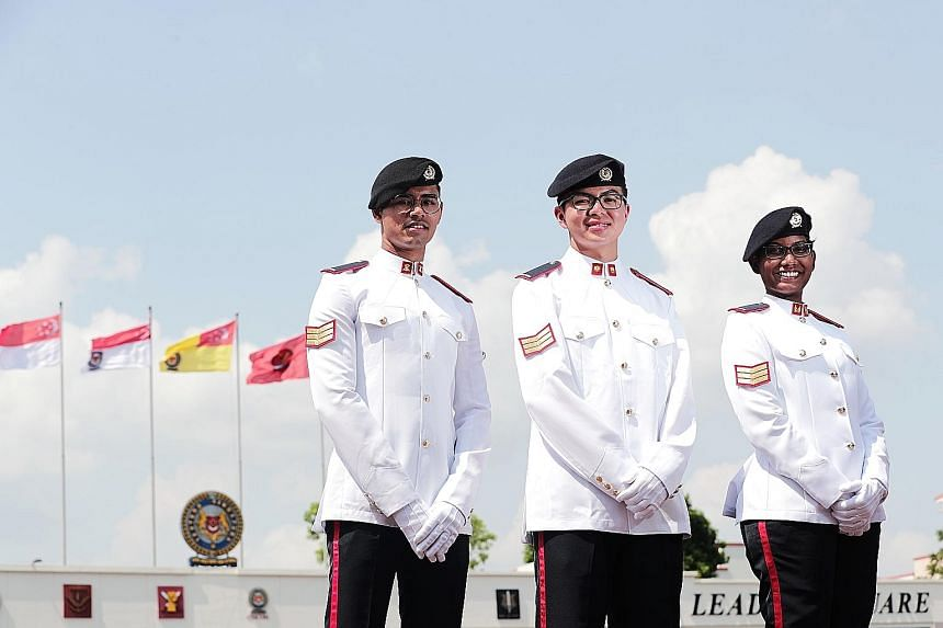 (From left) Armoured infantry specialist Saif Erfan Mohamed, 20; cyber specialist Tan Jia Le, who received one of 13 Golden Bayonets; and signals specialist Thaneswari P. Manoharan, 23, were among those who took part in the 40th Specialist Cadet Grad