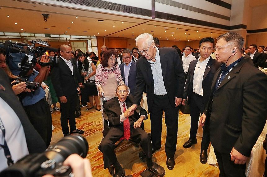 Emeritus Senior Minister Goh Chok Tong greeting Mr Chiam See Tong at last night's Chiam See Tong Sports Fund gala dinner. Mr Chiam made a surprise appearance midway through the event when he was wheeled in by his wife Lina. Also there to greet Mr Chi