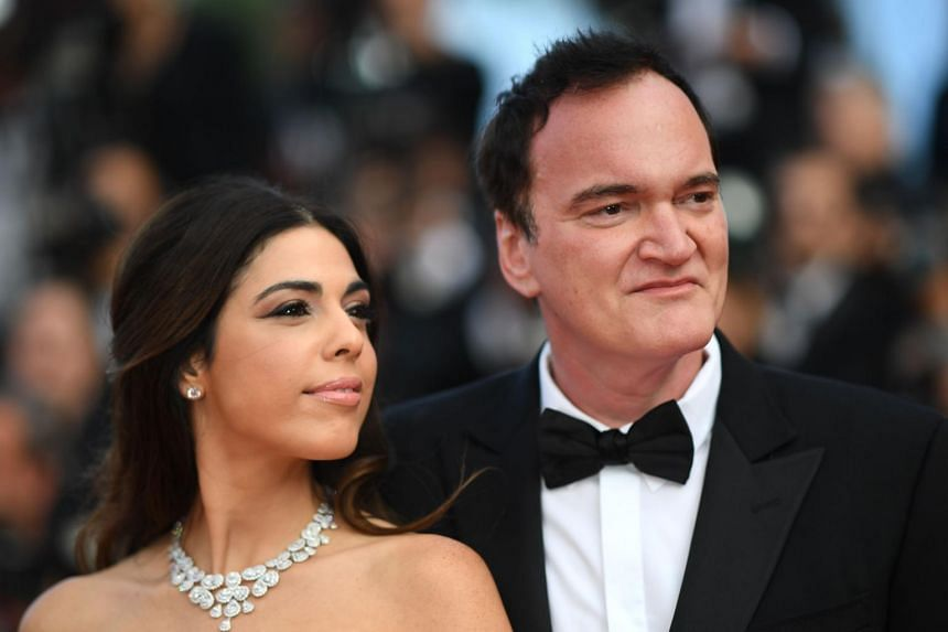 Quentin Tarantino and his wife Daniella Pick pose as they arrive at the Cannes Film Festival in France, on May 25, 2019.