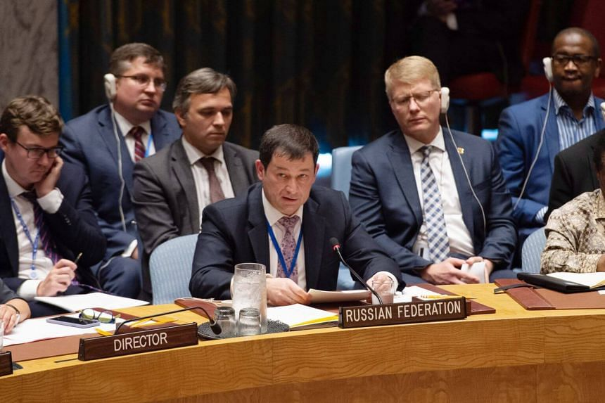 """Russia's deputy UN ambassador, Mr Dmitry Polyanskiy (centre), criticised what he called American """"hypocrisy,"""" saying the US """"consistently and deliberately violated the INF treaty for some time."""""""