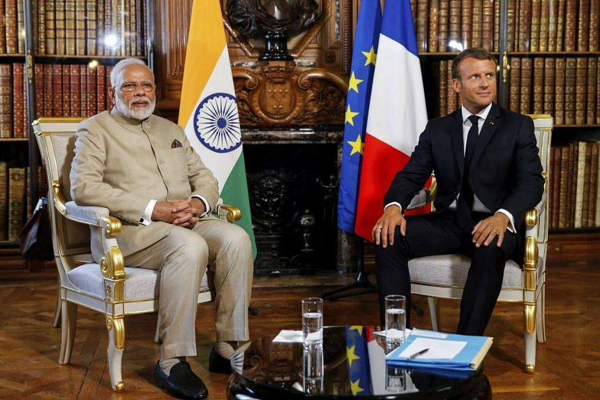 Indian Prime Minister Narendra Modi (left) attends a meeting with French President Emmanuel Macron at the Chateau of Chantilly in Paris, on Aug 22, 2019.