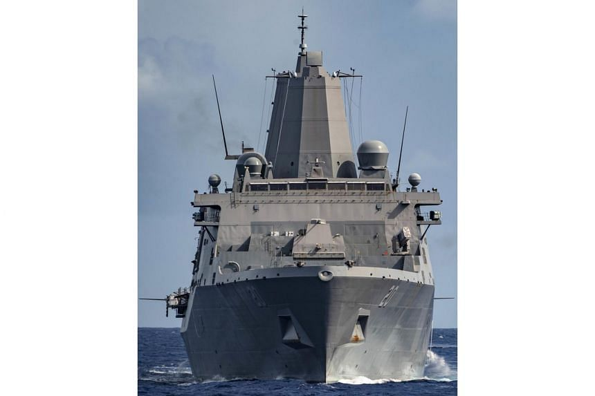 In a handout photo taken on June 8, the amphibious transport dock ship USS Green Bay (LPD 20) sails in the Philippine Sea during a training exercise.