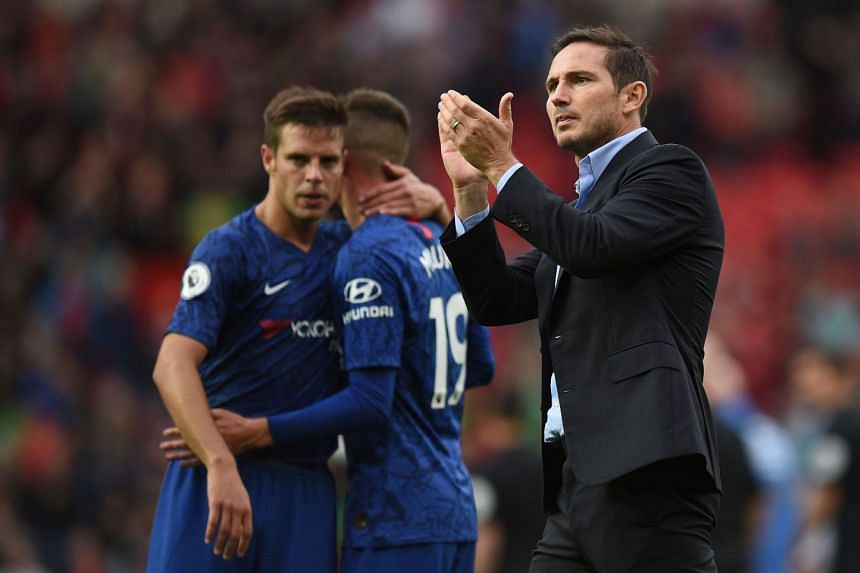 Lampard applauds supporters at the final whistle of the match against Manchester United.