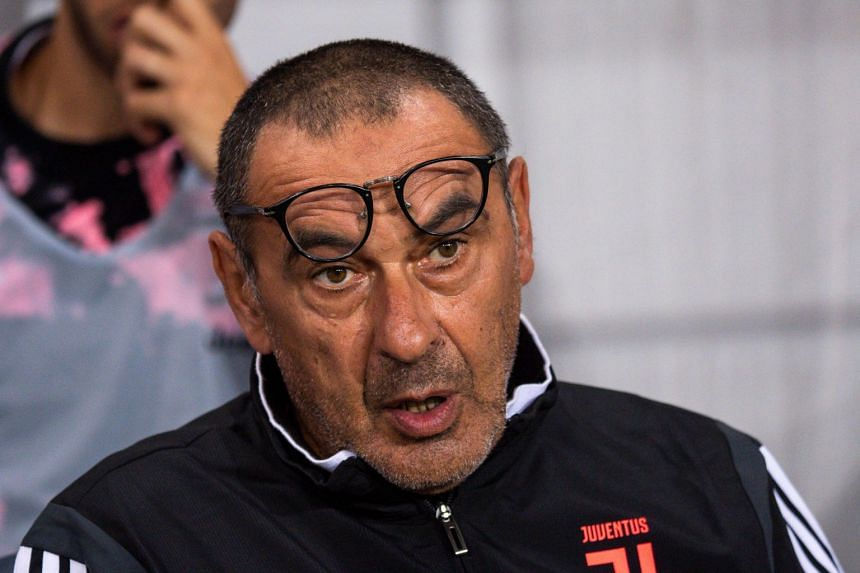 Sarri (above) will miss Juventus' matches against Parma and Napoli.