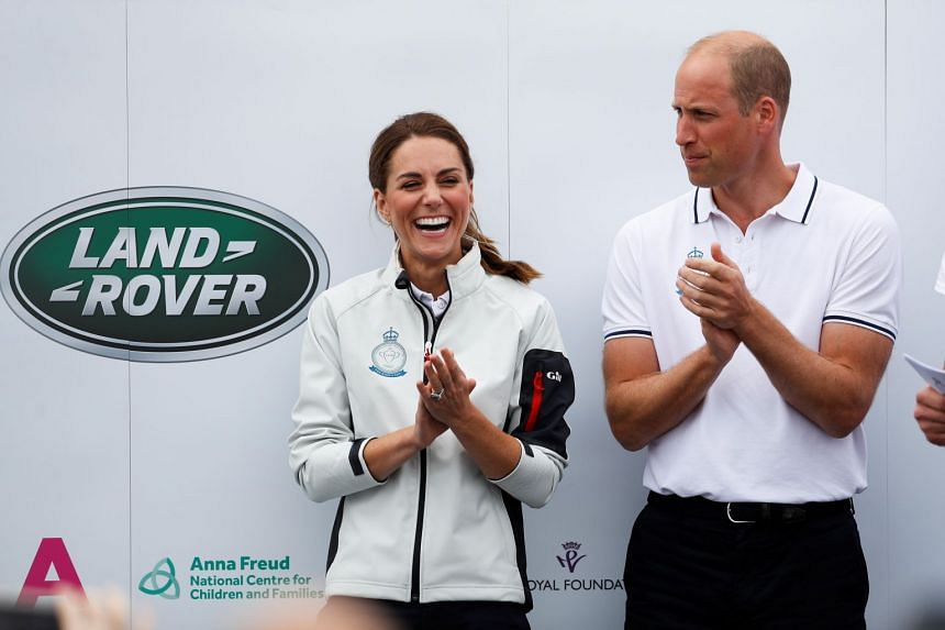 In a photo taken on Aug 8, Catherine Duchess of Cambridge smiles next to Britain's Prince William as they attend a prize presentation ceremony in the Isle of Wright.