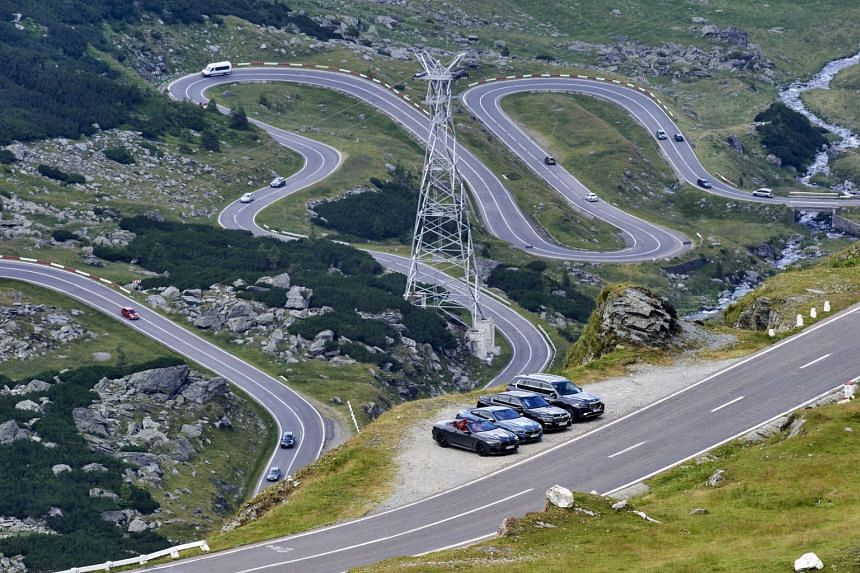 (Above from left) The BMW 850i Convertible, 850i Coupe, 7 Series and X7 xDrive40i overlooking a section of the Transfagarasan Highway.