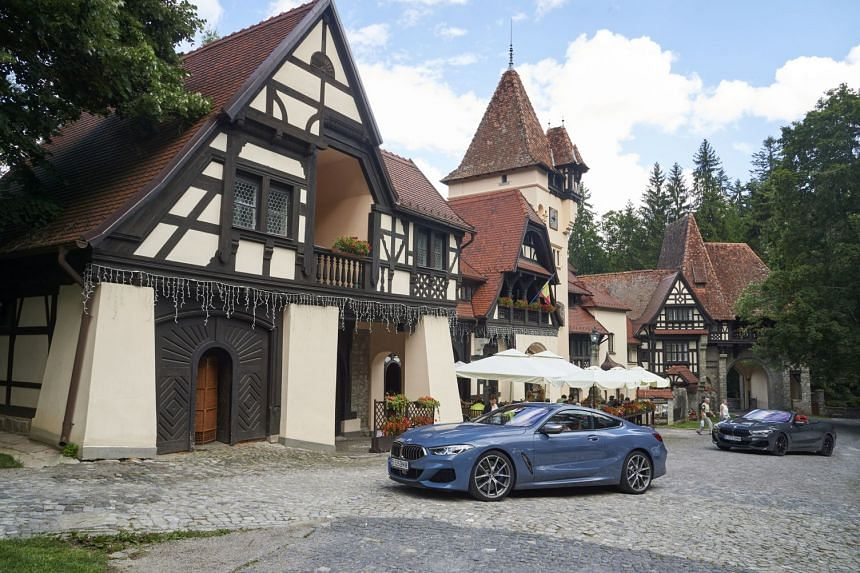 The BMW 850i Coupe (left) and the 850i Convertible at a lunch stop at Carol Gastro Bierhaus.