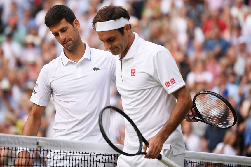 Djokovic (left) shakes hands with Federer after beating him during their Wimbledon final.