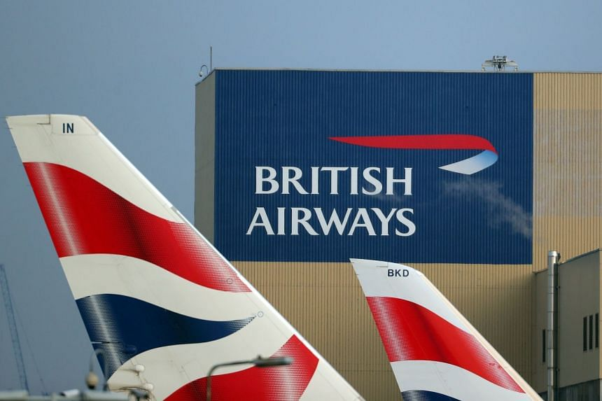 British Airways logos are seen on aeroplane tail fins at Heathrow Airport in London.