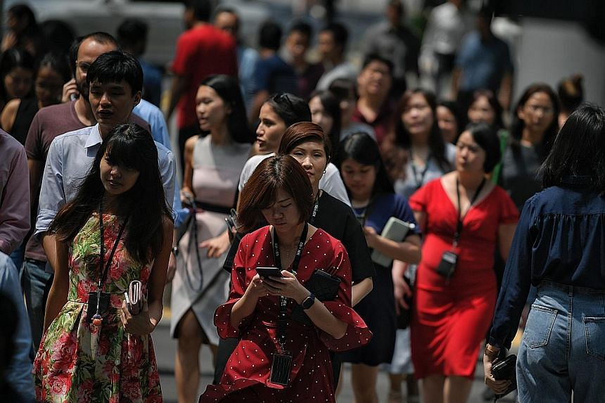 The Salary Benchmark 2019 report also showed that 29 per cent of Singapore professionals would switch jobs to develop new skills, while 60 per cent of job seekers felt positive about the employment market. ST PHOTO: MARK CHEONG