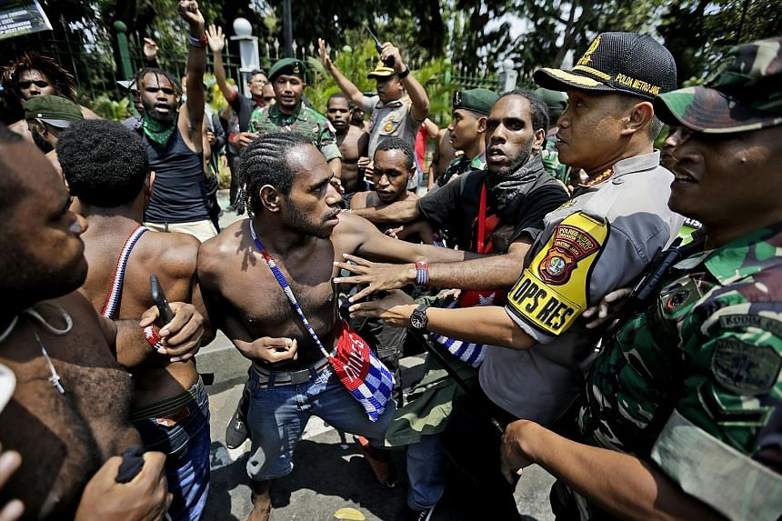 Papuan activists scuffling with police and soldiers during a rally near the presidential palace in Jakarta on Thursday. The latest spate of demonstrations was triggered by a racist slur against Papuan students.