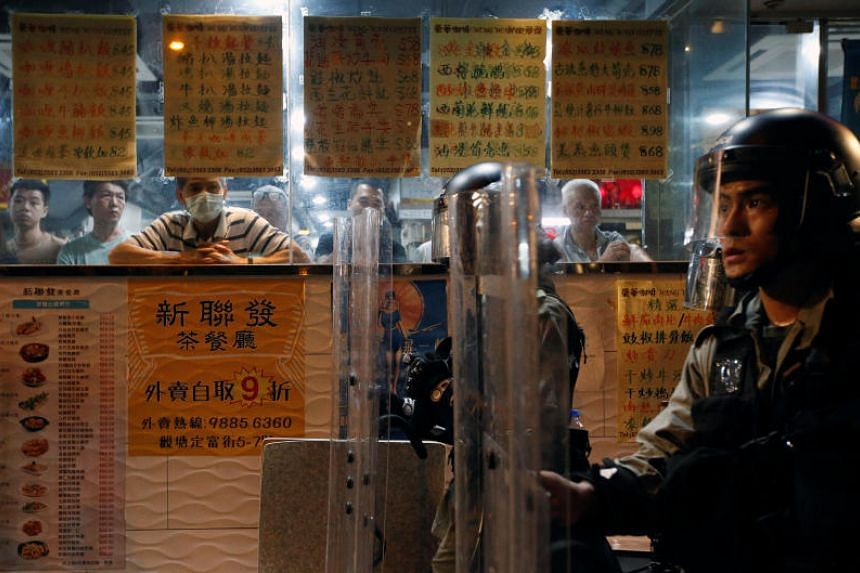 Riot police outside a restaurant in Hong Kong's Kwun Tong district on Aug 24.