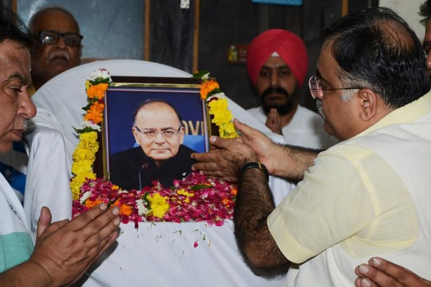 Bharatiya Janata Party (BJP) national secretary Tarun Chugh (right) along with BJP workers pay tribute to India's former finance minister Arun Jaitley, in Amritsar on Aug 24 ,2019.