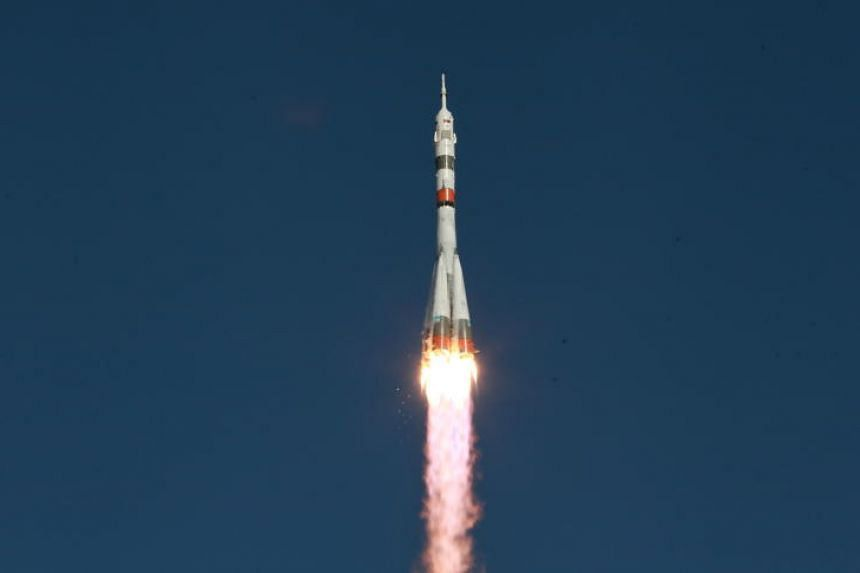 A handout photo taken on Aug 22 shows the Soyuz MS-14 spacecraft containing a humanoid robot lifting off from the launch pad at the Russian-leased Baikonur cosmodrome in Kazakhstan.