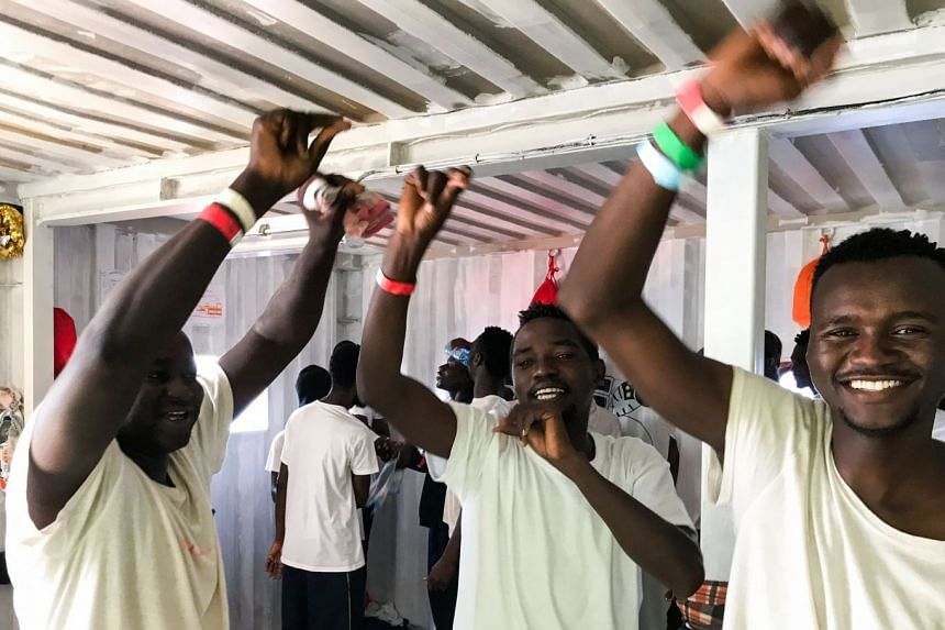 Migrants celebrate aboard the 'Ocean Viking' rescue ship.