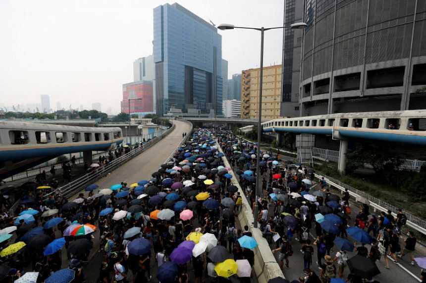 Protesters march in Hong Kong on Aug 24.