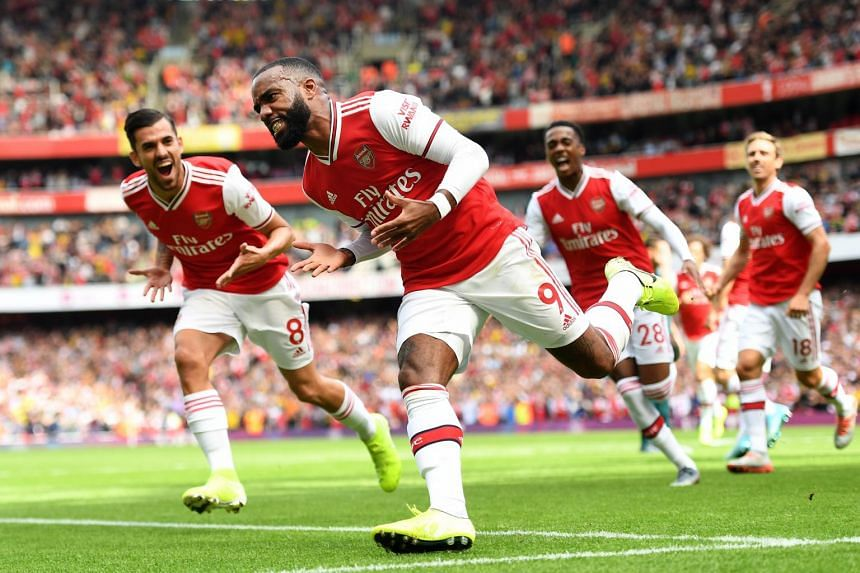 Arsenal's Alexandre Lacazette celebrates after scoring during the English Premier League football match between Arsenal and Burnley at the Emirates Stadium in London on Aug 17, 2019.