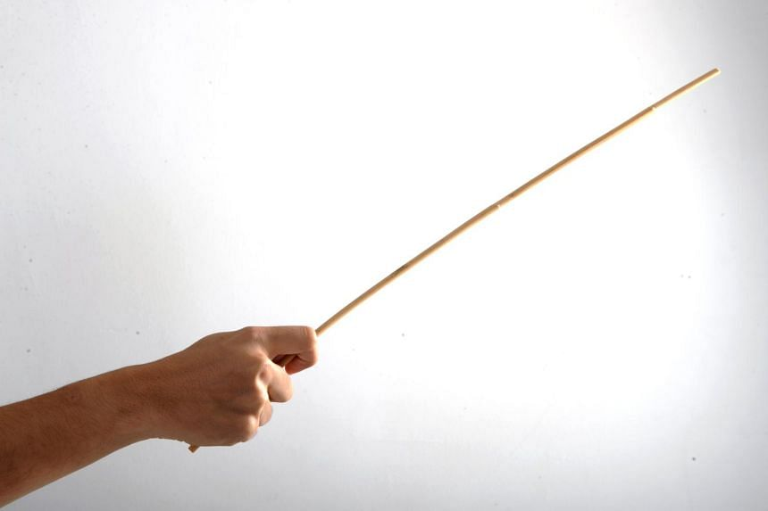 Posed photo of a hand holding a cane.