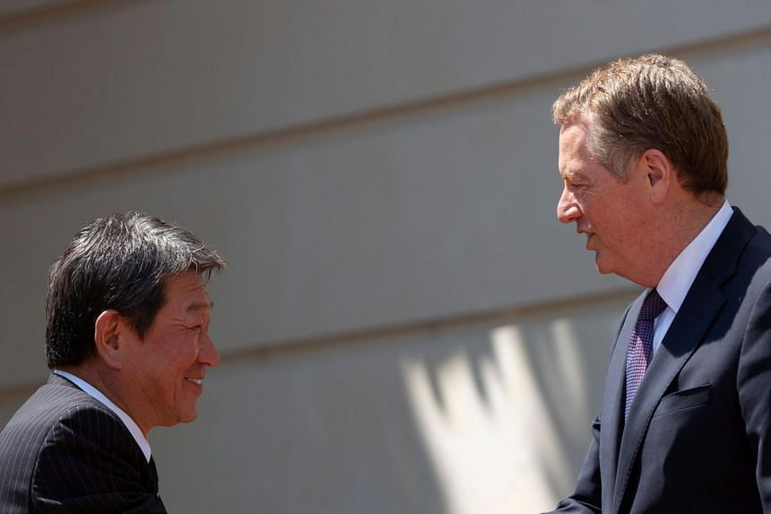 In a picture taken on Aug 1, 2019, Japanese Minister of Economic Revitalization Toshimitsu Motegi and US Trade Representative Robert Lighthizer meet prior to trade negotiations at the Office of the United States Trade Representative in Washington, DC