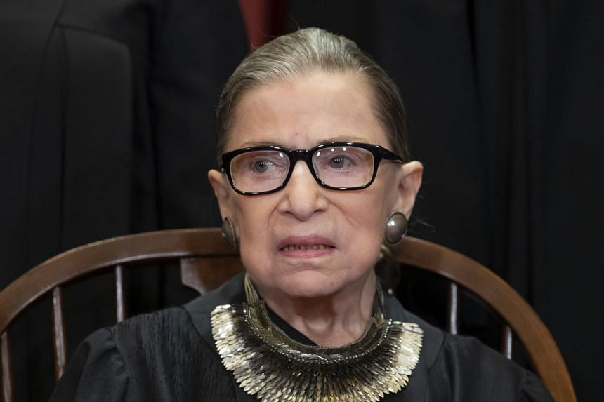 A 2018 photo shows Ginsburg sitting with her fellow Supreme Court justices for a group portrait.