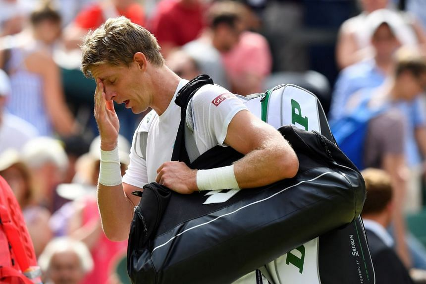 Anderson looks dejected after losing his third-round Wimbledon match against Argentina's Guido Pella.
