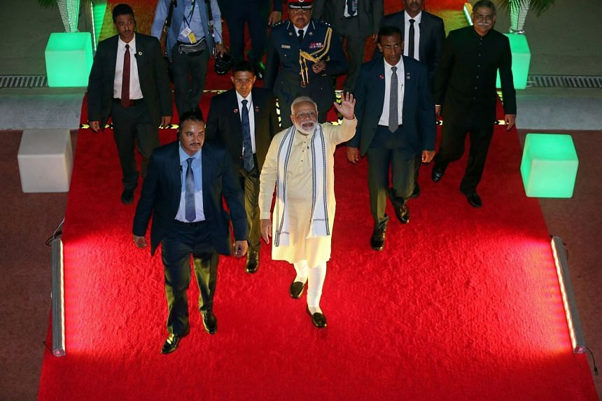 Modi waves at the crowd after his speech during his two-day visit in Manama, Bahrain.