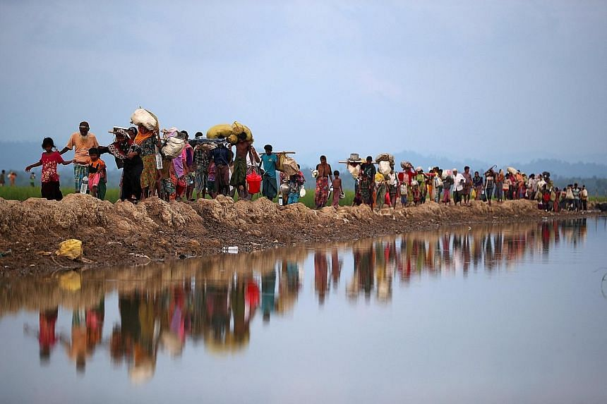Rohingya refugees crossing from Myanmar into Palang Khali, near Cox's Bazar, Bangladesh, in November 2017. Of the 911,000 people sheltered in Cox's Bazar, nearly 740,000 left Rakhine state following brutal violence in August 2017.
