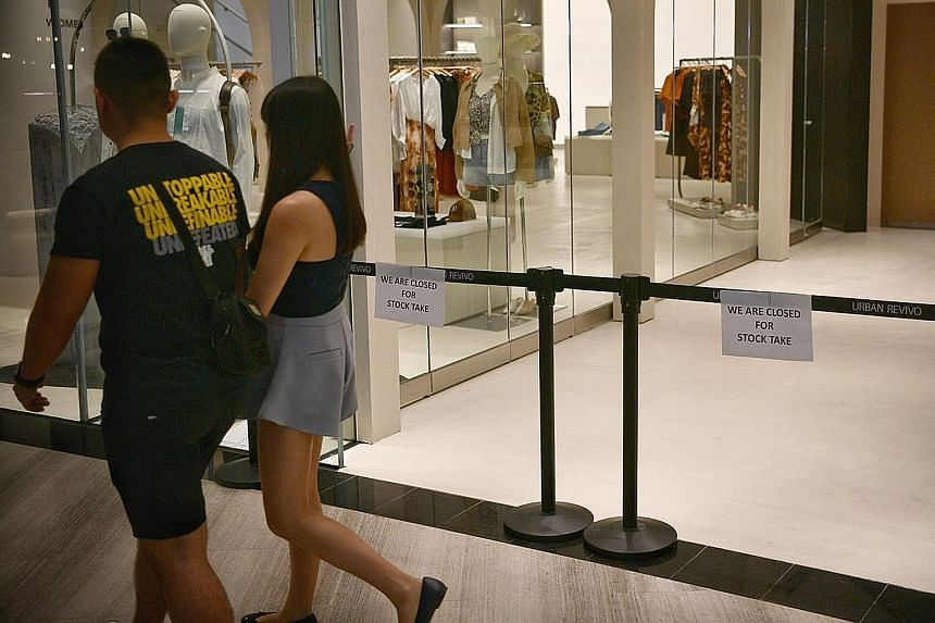 """The Urban Revivo store at Jewel Changi Airport remained cordoned off, with signs saying it was """"closed for stock take"""", when The Sunday Times visited yesterday evening."""