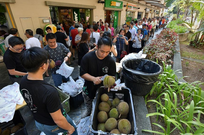 To celebrate Singapore's 54th birthday, a durian shop gave away hundreds of the spiky fruit to older Singaporeans yesterday. They were snapped up within 45 minutes. Yi Liu Ji Durian in Choa Chu Kang gave one XO durian to each senior who presented his