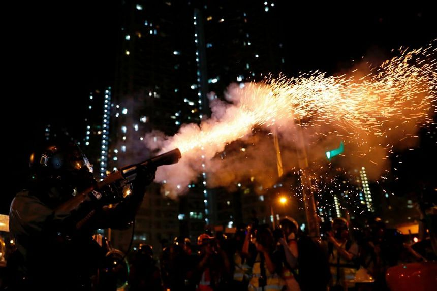 Riot police fire tear gas to disperse anti-extradition bill protesters after a march to demand democracy and political reforms, at Wong Tai Sin, Hong Kong on Aug 24, 2019.