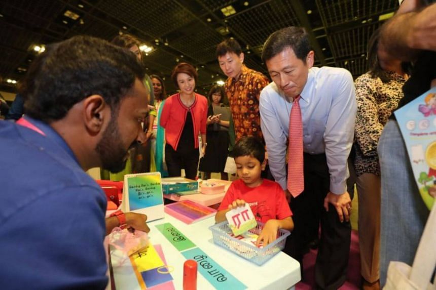 Education Minister Ong Ye Kung visiting the Tamil Language Learning and Promotion Committee's booth at the 8th Mother Tongue Languages Symposium on Aug 25, 2019, with Senior Minister of State for Education Chee Hong Tat and Senior Parliamentary Secre