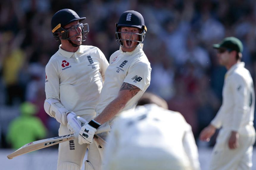 England's Ben Stokes (centre) with Jack Leach celebrates after scoring the winning runs on the fourth day of the 3rd Ashes Test cricket match between England and Australia at Headingley cricket ground in Leeds, on Aug 25, 2019.