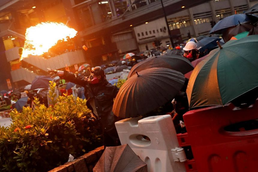 A demonstrator throws a Molotov cocktail during a clash with riot police at a protest in Hong Kong on Aug 25, 2019.