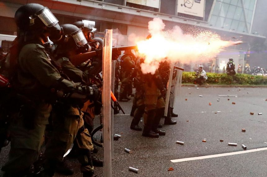 Riot police shoot a tear gas canister during a protest in Tsuen Wan, in Hong Kong on Aug 25, 2019.