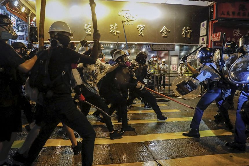 Policemen clash with demonstrators on a street during a protest in Hong Kong on Aug 25, 2019.