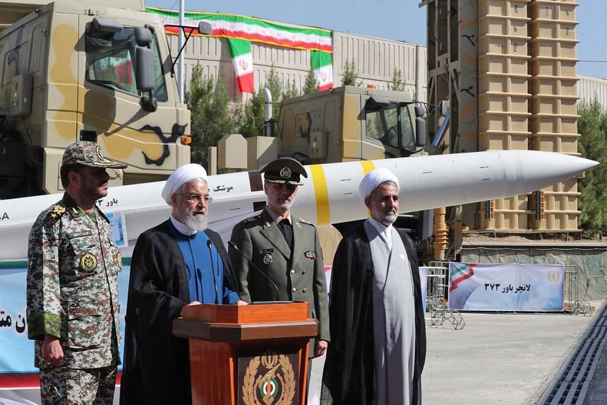 President Hassan Rouhani, seen here with Defence Minister Amir Hatami (third from left), announcing the debut of Iran's air-defence missile system, the Bavar-373, in Teheran last Thursday.