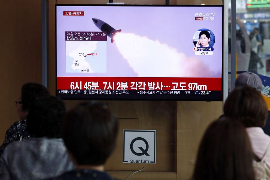 People watching news of North Korea's projectile launch at Seoul Station yesterday. It was the seventh launch by North Korea since United States President Donald Trump and North Korean leader Kim Jong Un met at the inter-Korea border in June.
