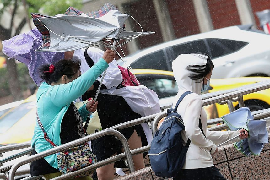Typhoon Bailu brought on a downpour and strong winds in Taipei yesterday. Taiwan shut businesses and schools as airlines cancelled hundreds of flights, amid warnings of landslides, floods and high seas on the island. Bailu, categorised at the weakest
