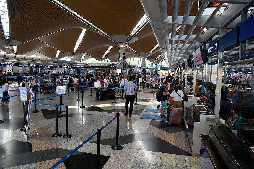 Operations at check-in counters of Kuala Lumpur International Airport seemed to be returning to normal yesterday, after a systems disruption hit the airport last Wednesday. PHOTO: BERNAMA
