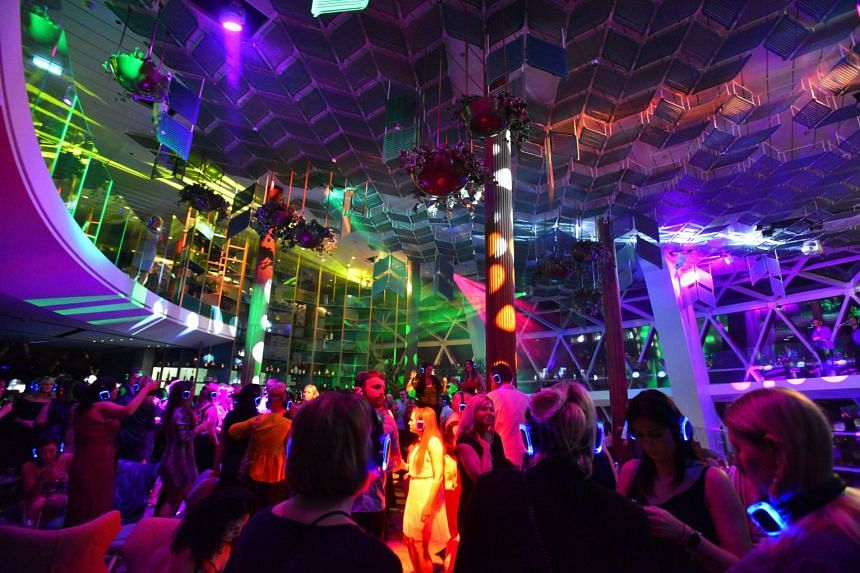 Clubbers in a silent disco at transformative space Eden on the Celebrity Edge, a new US$1 billion (S$1.38 billion) ship launched by Celebrity Cruises that aims to appeal to younger travellers.