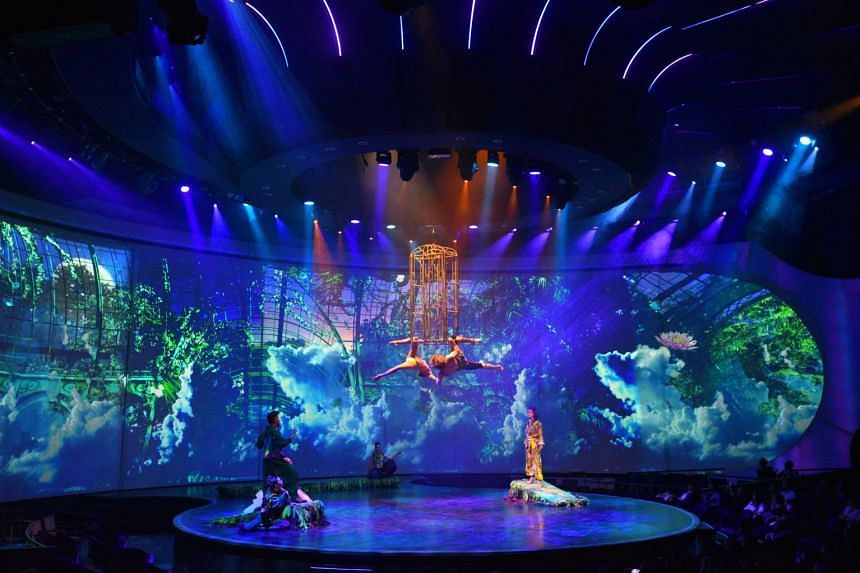 A Hot Summer Night's Dream being staged at The Theatre, which boasts four stage areas and three projected backdrops.