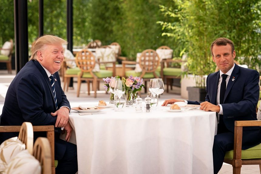 Trump (left) and Macron lunch at the Hotel du Palais, ahead of the G-7 Summit.