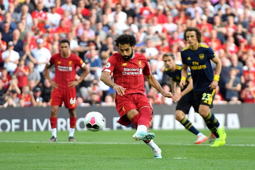 Liverpool's Mohamed Salah scores his side's second goal of the game from a penalty.